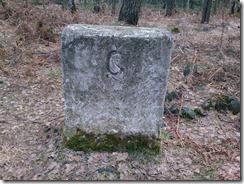 Grenzstein mit alter Inschrift